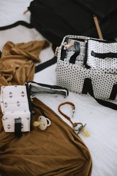 No-Fuss Hospital Bag Must-Haves You Need for Delivery and Recovery including diaper bag necessities for baby. What to pack in a delivery bag for mama. A go bag for dad. What to pack for a c section and what you DONT need to pack in a hospital bag.
