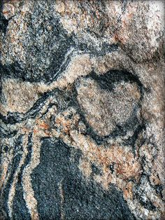 """LOOK FOR TWO FACE IN THE LOBES OF THIS HEART OUTLINE.   HOW MANY HEARTS DO YOU """"c""""?   Rock heart"""