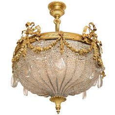 A Beautiful Gilt Bronze Ribboned and Wreath Beaded Chandelier by E. F. Caldwell | From a unique collection of antique and modern chandeliers and pendants  at https://www.1stdibs.com/furniture/lighting/chandeliers-pendant-lights/