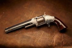 SMITH & WESSON NO. 2 REVOLVER: General William Tecumseh Sherman received this revolver as a presentation from his personal staff in 1869. The .32 rimfire S No. 2 was a popular officer's selection in the American Civil War era as it was one of the first metallic cartridge handguns.