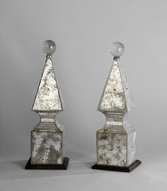 Pair of obelisks by Serge Roche (1898-1988), Circa 1935 - Each obelisk is made of patinated mirrors and is set on a blackened wooden base. A glass ball overlooks the whole scheme.