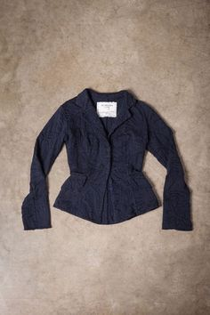 """This blazer is hand stitched in 100% organic medium-weight cotton jersey with reverse appliqué in our Magdalena stencil. Flares slightly at the waist and features crocheted snap closures and pockets. Measures 25"""" from shoulder. Shown here in Navy. Choose your color below.Please allow four to six weeks for delivery. Wash gently + Hang to dry. Free domestic shipping. Made in the USA."""