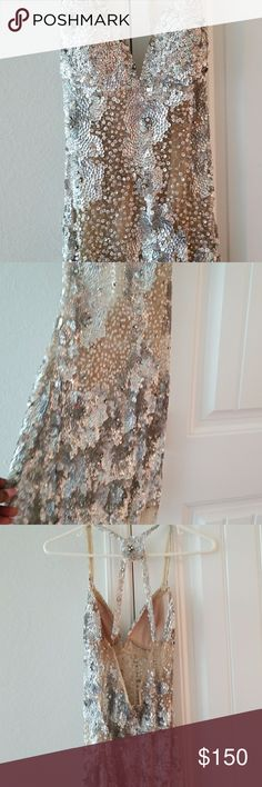 Jovani sequin sheer dress Silver sequin and sheer knee length Jovani Dresses Prom