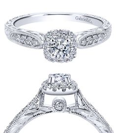A delicate diamond beneath the center stone in this 14k White Gold Victorian Halo Engagement Ring.