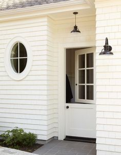 Round window inspiration - white exterior with black barn lights More