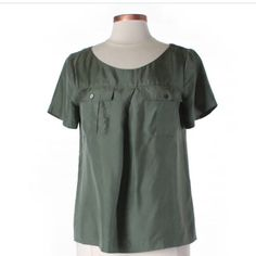 J.Crew Silk Top.  J.Crew Women's Silk Utility Tee 100% Silk Military Green Pockets Buttons 6. *PHOTO USED FOR MODEL. SHIRT IS OLIVE/MILITARY GREEN. Send your offer!!!  J. Crew Tops Blouses