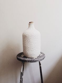 Hand-carved porcelain bottle.