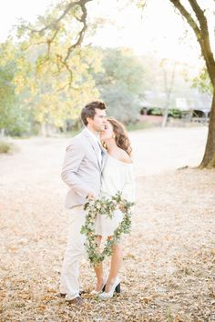 Couple posing with a wedding wreath | Film Photography: Is It Right For You?