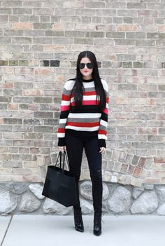 Striped sweater, skinny black jeans, black ankle boots and black tote.