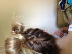 Upside down ponytail braid.