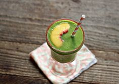 Juicy ripe peaches and a zing of ginger give this Ginger Peach Green Smoothie a bit of zip and whole lot of sass.
