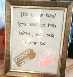 Father Day gift from a toddler mindee to her Daddy. Littke poem and pink hand print. Plus a little luggage tag.