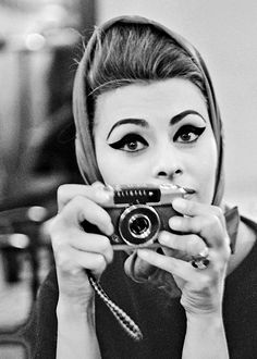 I HAVE ALWAYS ADORED CAT EYE EYELINER, BUT FOR ONCE I AM TAKEN ABACK--METHINKS SOPHIA LOREN GOT A BIT CARRIED AWAY, UNLESS SHE WANTED IT TO BE SEEN FROM SPACE!