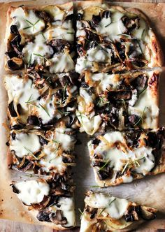 A savory pizza with caramelized onions, mushrooms + rosemary potatoes with garlic cream sauce.