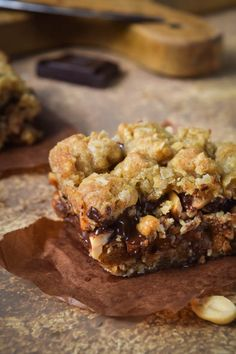 crunchy, salty peanuts layered with chocolate and dulce de leche carmel in between peanut butter oatmeal cookie layers