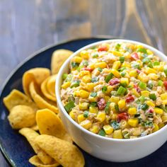 Skinny Mexican Corn Dip Recipe Appetizers with 2% lowfat greek yogurt, olive oil mayonnaise, chili powder, garlic powder, cumin, mexicorn, shredded reduced fat cheddar cheese, green onions, jalapeno chilies, hot sauce, Cholula Hot Sauce, fritos
