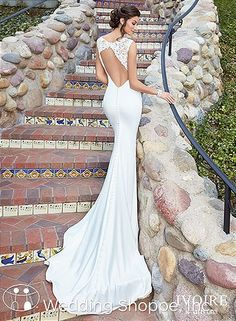This sleek wedding dress from Kittychen Couture has a stunning keyhole back.