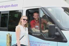 Tom and Lisa from Go Cotswolds, pictured with their 16-seater branded minibus