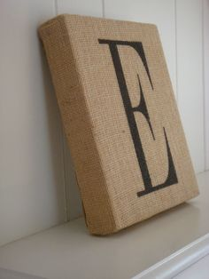 Wrap a canvas in burlap, stencil letter w/ fabric paint or permanent marker