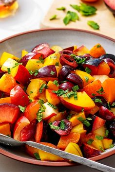 NYT Cooking: Summer is the season of stone fruit — juicy cherries, sweet peaches, perfect plums. Add a little mint and honey and you've got an amazing summer salad that is a turn away from the usual melon-heavy versions popular on picnic tables and at barbecues.