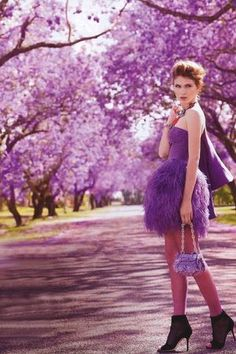 Purple dress, purple trees...  OK,... I wouldn't be caught DEAD in this type of outfit...  But, purple dress, purple trees...PURPLE STUFF!!!  LOL