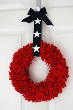 another patriotic wreath to consider for the 4th.  She used red felt stars (hand cut).