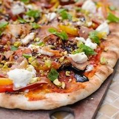 Rustic Italian Farmhouse Pizza – a complete meal on a pizza. Includes prosciutto, ricotta, yellow peppers, basil, pistachios and balsamic.