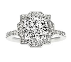 Belle by Harry Winston.  Round brilliant diamond, 2.01 carats, with micropavé; total weight 2.40 carats; platinum setting. Collection begins with 0.50 carat center stones.