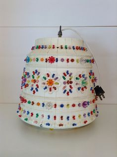 Vintage Lawnware Hanging Lamp DIY - Plastic Flower pot and melamine cheap 3 prong gems. Outdoor Hanging Lights, Diy Hanging, Outdoor Decor, Plastic Flower Pots, Pot Lights, Bead Store, Camping Lights, Lanterns Decor, Diy Projects To Try