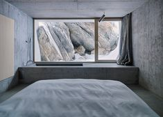 Situated in Flims, in the Swiss Alps, the 40-square-metre house known as Concrete Cabin replaces an aged log cabin to provide a holiday home for up to two people. | Photo: bathroom details