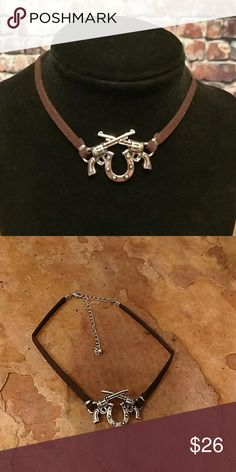 "Double Pistol Choker Two crossed Guns and horseshoe on this deep brown faux suede strap. Can be worn from 12"" to 16"". Bohol, Bohemian, Western, Cowgirl, Southwest, Gypsy Hippie ■ Price Firm Unless Bundled  ■ I Do Not Trade Boutique Jewelry Necklaces"