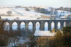 This morning sun rose over the Hewenden Viaduct near Cullingworth in west Yorkshire, with the are waking to crisp sunshine Cold Night, Snow Scenes, West Yorkshire, Morning Sun, Brooklyn Bridge, Britain, Crisp, Sunrise, Places To Visit
