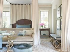 Lustrous fabrics, such as velvet and silk, cocoon the master bedroom.