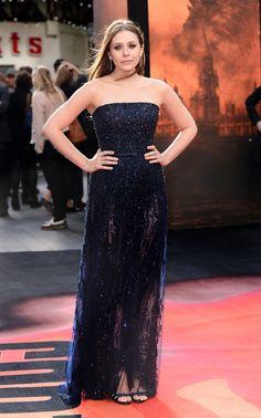 Elizabeth Olsen shows off her chic sense of style in this midnight blue Badgley Mischka strapless gown