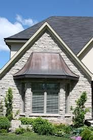 copper roofing over bay windows Copper Roofing Upper Canada Cedar Roof Copper Awning, Metal Awning, Copper Roof, Front Door Awning, Window Awnings, Front Porch, Roof Christmas Lights, Cedar Roof, Exterior Makeover