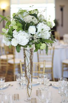 Elevated green and white arrangement by Loda Floral Design  photo by Isla & Magnolia