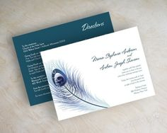 Wedding invitations, peacock feathers in white and blue tones. $59.00, via Etsy.