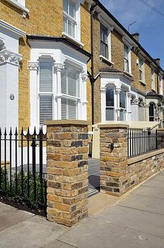 Brick wall, pier cap coping, Imperial metal gate and railing