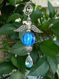 Cobalt blue puffed coin hand blown glass beaded hanging angel by LindaGillottiDesigns on Etsy