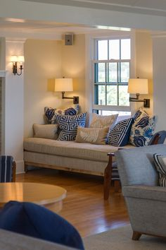 relaxing, comfy living room ... beige, cream, natural fabrics/linens & deep blue/navy accent pieces & throw pillows