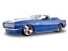 This Chevrolet Camaro Convertible (1968) Diecast Model Car is Blue and features working steering, wheels and also opening bonnet with engine, boot, doors. It is made by Maisto and is 1:18 scale (approx. 25cm / 9.8in long).    Old school, blinged out, NOSed up, and ICEd to the max!  What more could you ask for?...