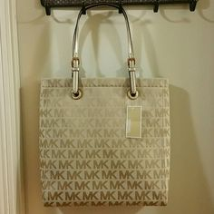 NWT MICHAEL KORS JET SET TOTE Brand new Michael Kors Jet Set Tote in beige and gold  MK signature with nude interior. The straps are gold in color and adjustable, there is 1 zipper pocket and 4 slip pockets inside. MICHAEL Michael Kors Bags Totes