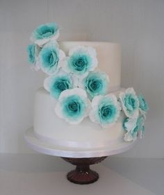 Lovely turquoise flowers.  I wouldn't be making them out of fondant though...