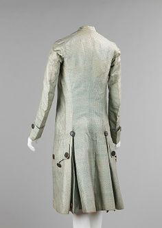 Back view, formal suit with coat and breeches, France, 1765-1775. Ice-blue silk, salmon coloured lining. Applied pink coloured metallic buttons.