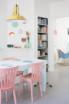 Pastel hues and quirky pops of neon layered upon a crisp white base - home tour on decor8 blog