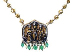 Lord Ram, Goddess Sita, Laxman in darbar posture. Pendant is studded with cut diamonds, emeralds and pearls, from Karni Jewellers.