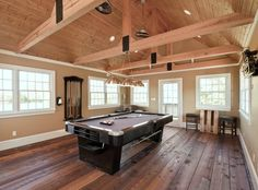 Craftsman Game Room with Pendant light, Crown molding, Glass panel door, Ceiling fan, Hardwood floors, Cathedral ceiling