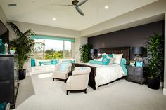 Master bedroom with formal seating area and bay window