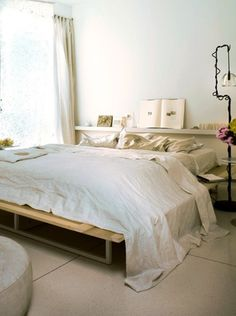 platform bed with then shelf as headboard