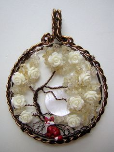 Idea: Tree of life pendant on a simple polymer clay base, roses or other flowers on top of the wire. (Can also be done in a cabochon base so resin can be poured on top)